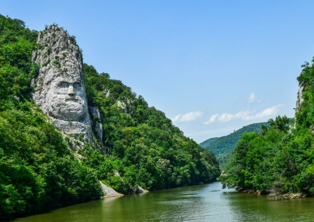 Decebal Statue in the Romanian Carpathaian Mountains which is 1 of the Top 20 Budget Travel Destinations in 2020 #travelclans #Romania #BudgetTravel #Travel #Destinations